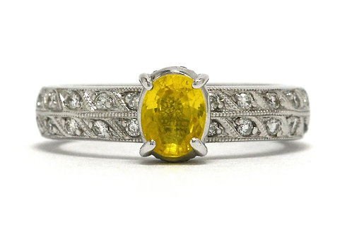 An oval faceted yellow sapphire diamonds white gold solitaire ring