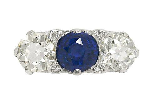 Blue sapphire three stone diamond trinity engagement ring