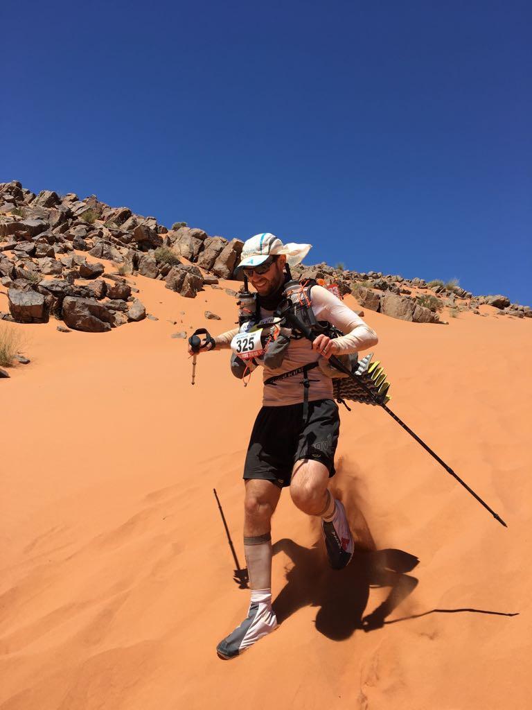 Matthew running down a sand dune