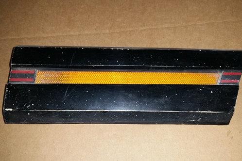 79-84 Mercury Capri LH front fender molding w/ light-Used