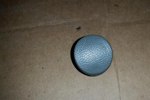 87-89 RH Gray armrest bolt cap-used
