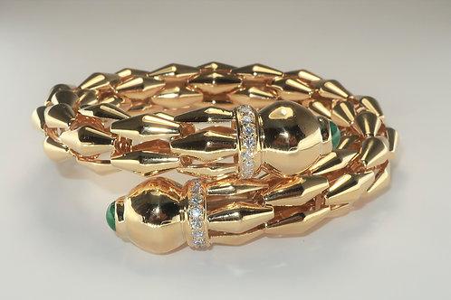 Unisex 18 karat Yellow Gold Emerald and Diamond Bangle Bracelet.