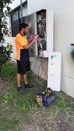 wyongair engineer working on outdoor unit