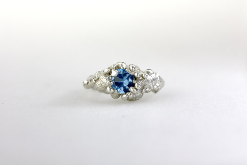 Melting Silver and Blue CZ Ring