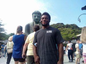 Alec next to the big buddah