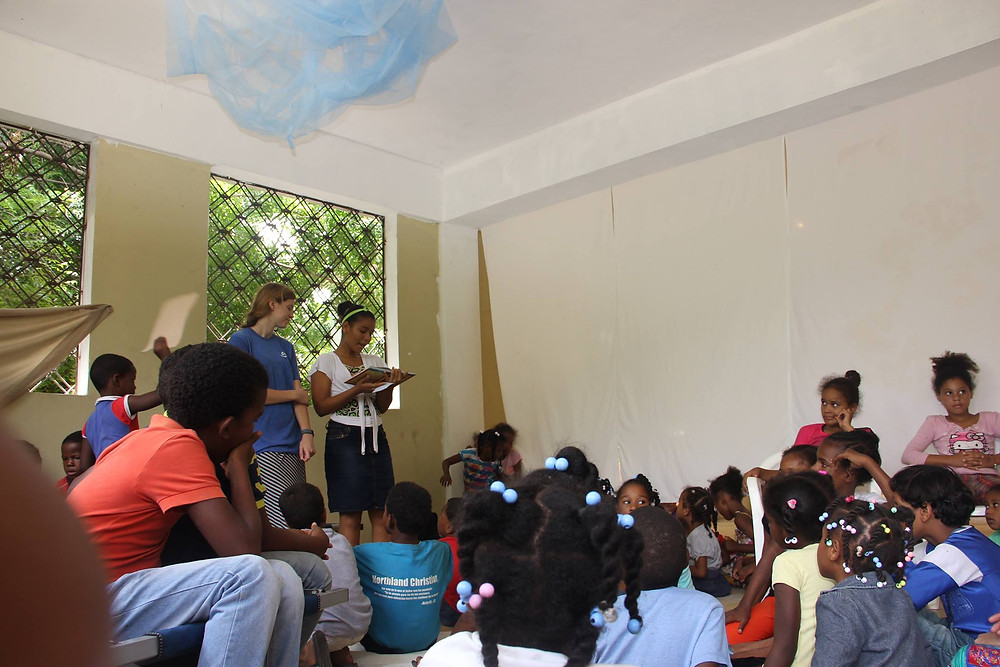 Estrella leading story time during a VBS. We love Jesus Storybook Bible!