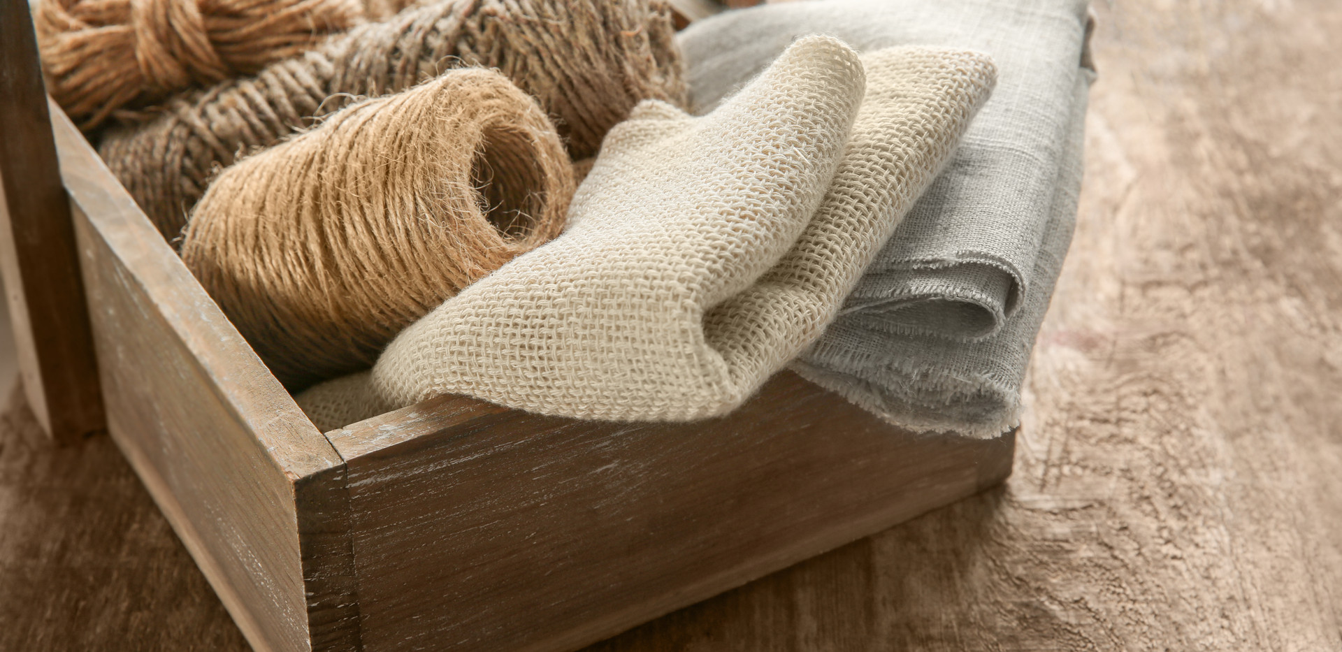 Hemp cloth and rope in crate on wooden b