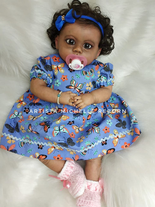 Bebê Reborn Emy 55cm e 2000g Corpo Tecido Enxoval Completo