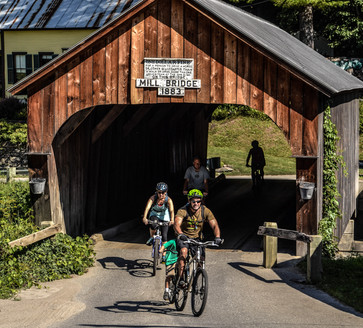 Riding through one of the two covered bridges on the Milk Run.