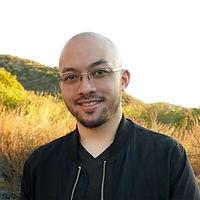 Chest up photo of Anthony Palileo smiling