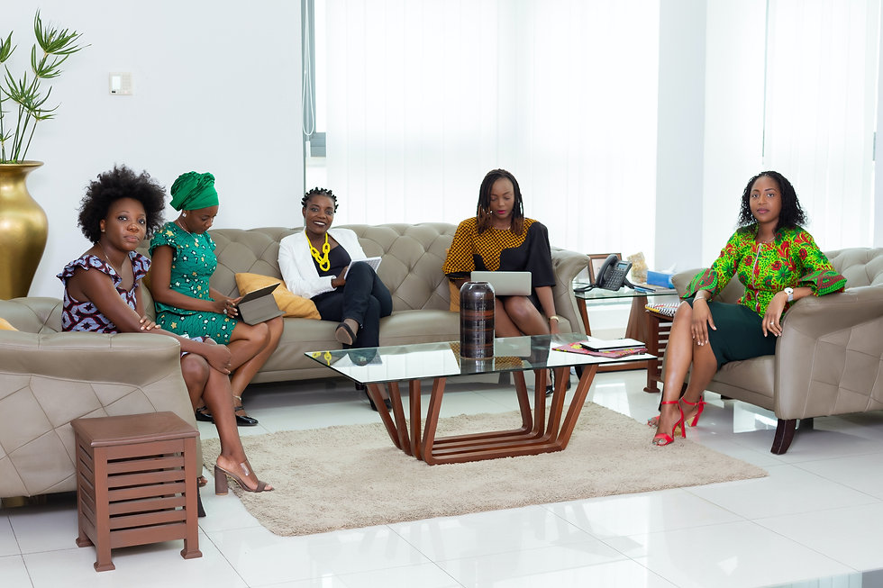 group-of-women-sitting-on-couch-3869651.