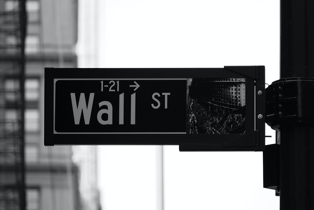 "A sign board which states "" wall street"""