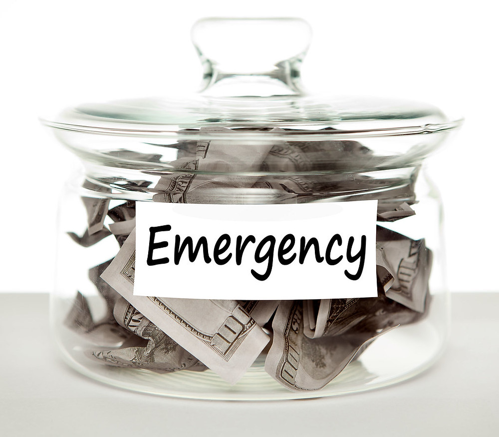 A jar filled with money for emergency purpose