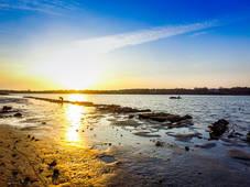 """Sunrise on Oyster Pond."""