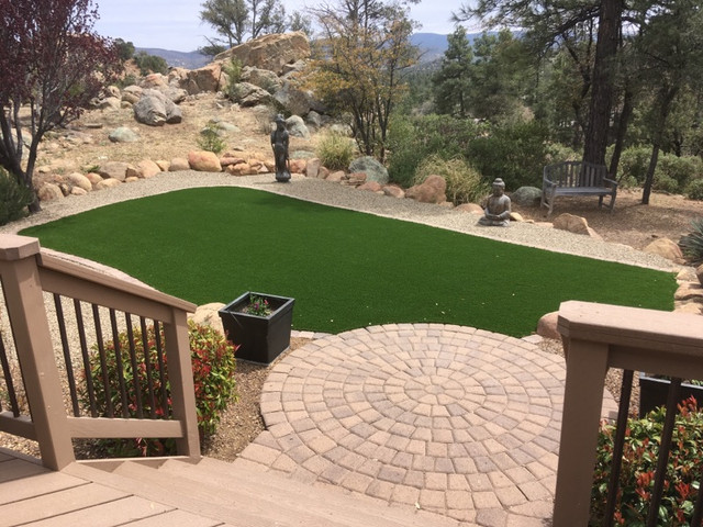 Artificial Turf in the Backyard with Pavers