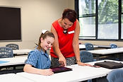 high school teacher photo helping studen