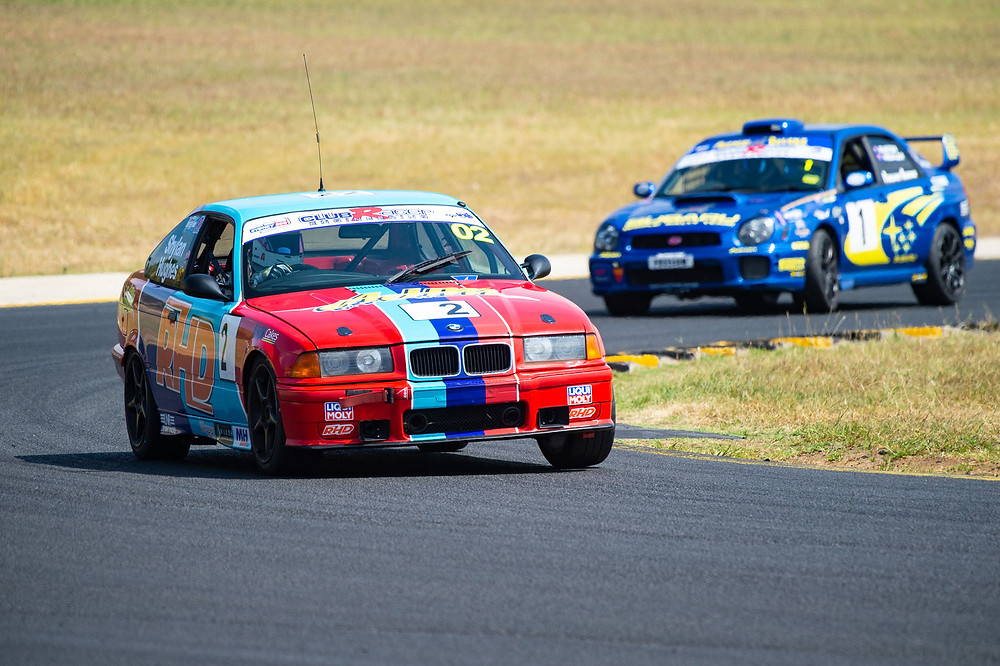 Matt Shylan in the BMW 318is leading the Subaru WRX at the Sydney 300