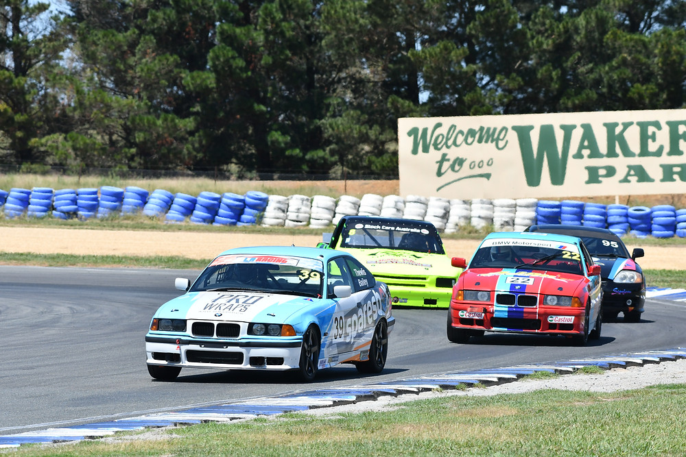 Adan Hughes in his E36 BMW leading the pack at Wakefield.