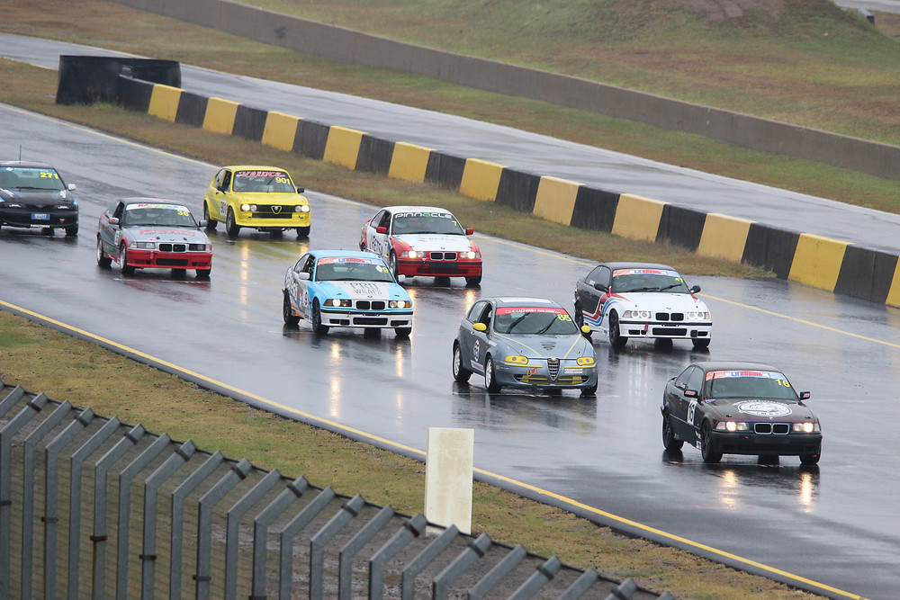 A grid of cars lined up for the start race one at Sydney Motorsport Park.