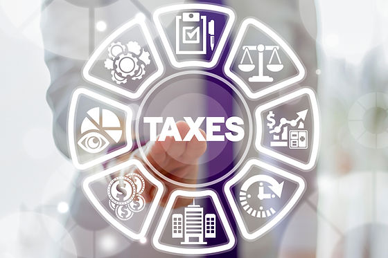 Business woman clicks a taxes word butto