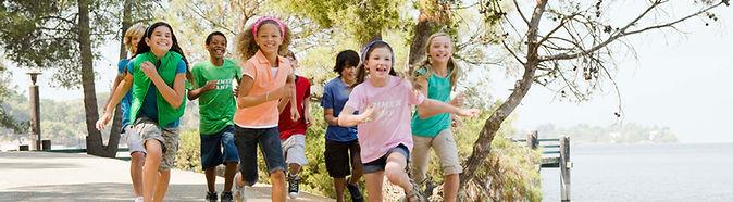 Children running at a park