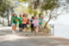 Children running on trail