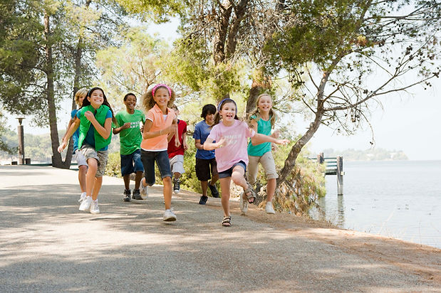 children running excitedly on their first day to camp