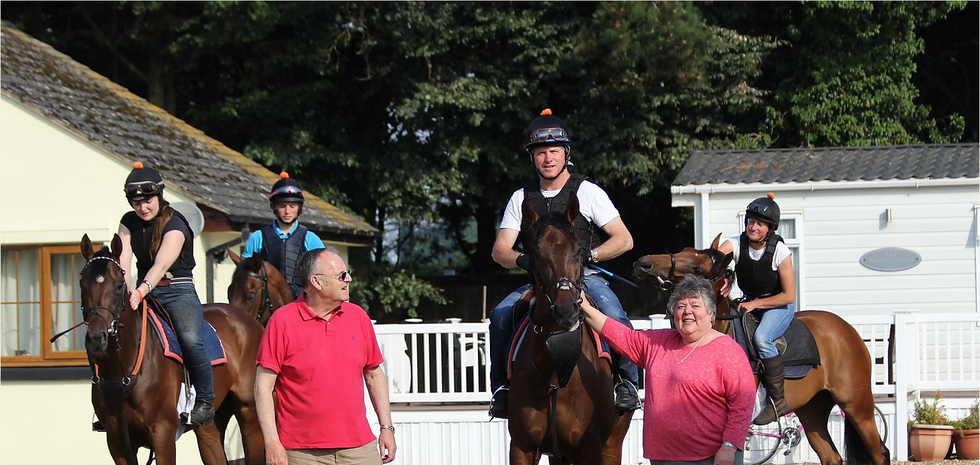 Owners Pat and Eddy Phillips and some of the team in the yard