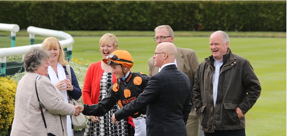 Robert, Tom Marquand and owners Pat and Eddy Phillips in the parade ring