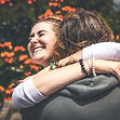 smiling-woman-hugging-another-person-229