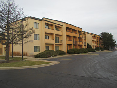 Exterior Hotel Renovation Before Courtyard by Marriott