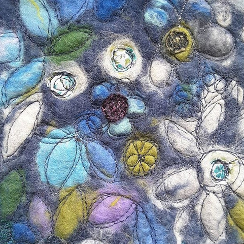Detail of machine embroidery and applique on wool felt