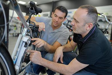 mechanic-repairing-battery-powered-bicyc