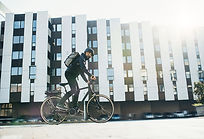 male-courier-with-bicycle-delivering-pac