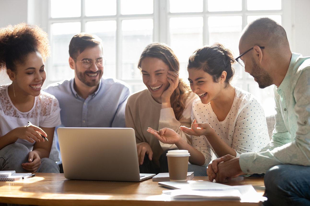 Multi-ethnic five laughing buddies sit o