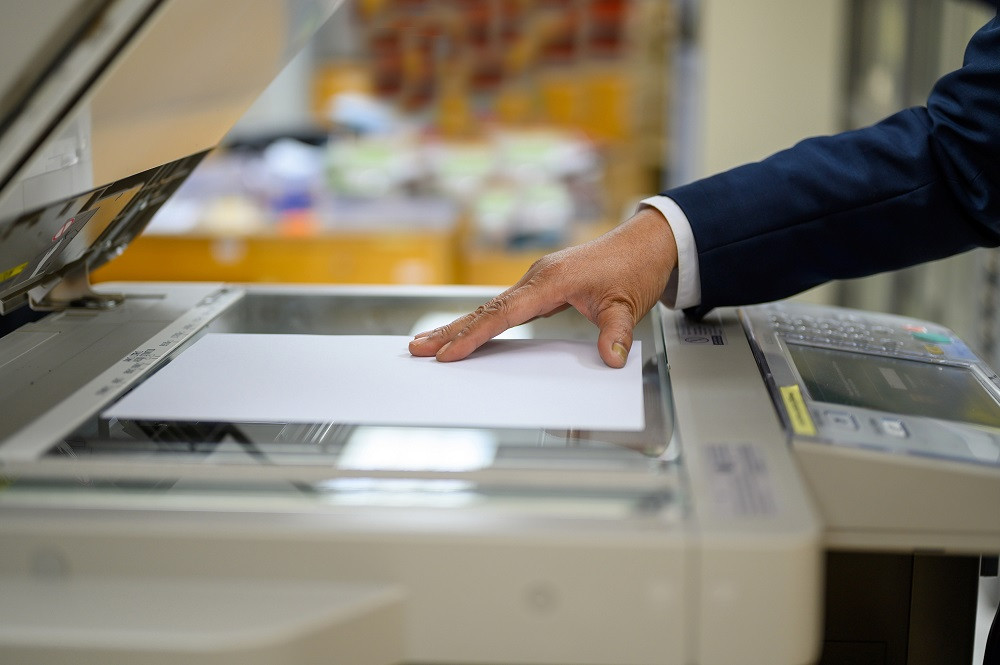 Employee using copy machine
