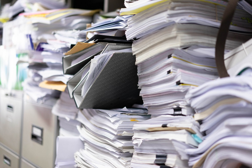 Messy piles of documents