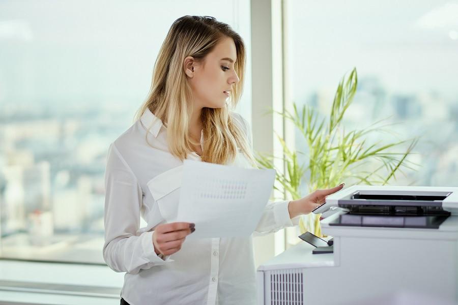Someone Using Big Copier Machine in Office
