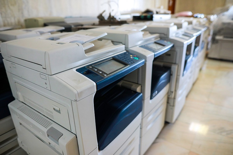 Several large copy machines in a row