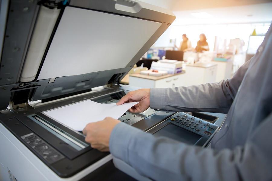 Man making copies on machine