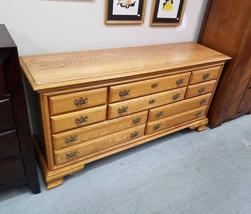 Eight Drawer Wide Oak Wood Dresser w/ Drop Handles