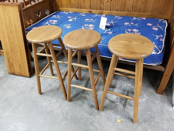 Matching Set of Three Round Top Oak Wood Bar Height Stools