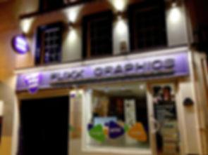 flixx graphics shop front windows window lights printing purple investor people plectrum