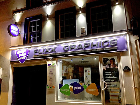 flixx graphics shop front windows window lights printing purple investor people plectrum