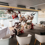 The wedding set up and florals on the deck of Ormeggio