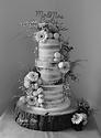 Beautiful semi-naked wedding cake by Amelia Rose.