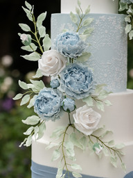 Beautiful pale blue & white wedding cake. picture courtesy of Sarah Vivienne Photography.
