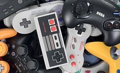console-wars-pile-of-controllers-1.jpeg