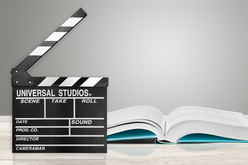 Movies adapted from books, cinema concept with clapboard and book.jpg
