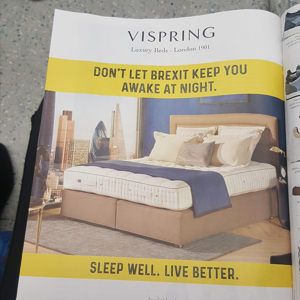 """A Vispring Luxury Beds ad, featuring a beautiful king size bed with a blue decorative throw and a tagline """"Don't let Brexit keep you awake at night/Sleep well. Live better."""""""